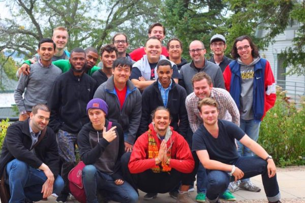 A diverse group of male students posing for a picture