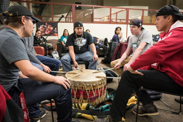 UW-Madison students sing a welcome song at Native November feast event