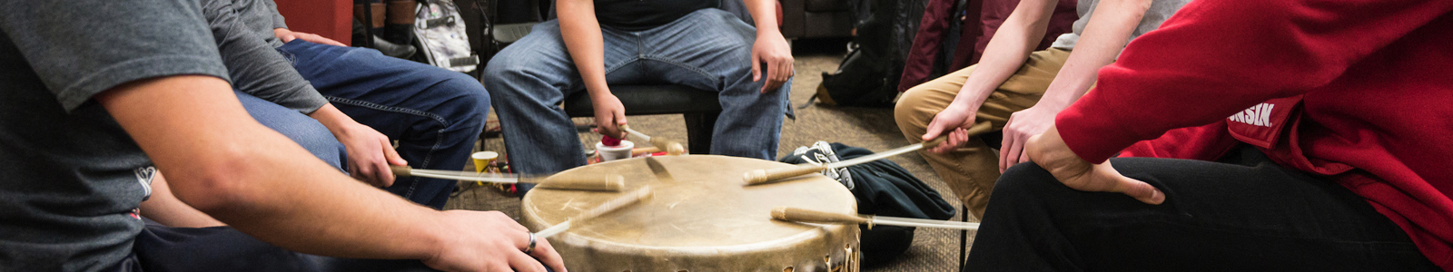 Students performing in a drum circle