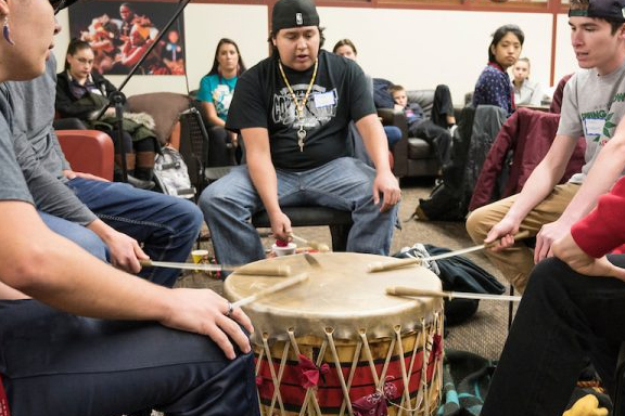 Students perfoming in a drum circle